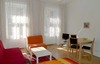 Spacious living room with double bed, sitting corner and eating place in your apartment Vienna
